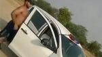 போலீஸ் காரில் நடந்த அதிர்ச்சி சம்பவம் இதுதான்... சமூக வலை தளங்களில் வைரலாகும் வீடியோ...